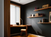 Raised-wooden-floor-delineates-this-black-and-wood-home-office-from-the-living-area-58756-217x155