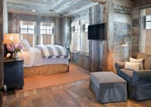 Reading-nook-in-ths-rustic-bedroom-is-fashioned-using-just-a-floor-lamp-comfy-chair-and-ottoman-96976-217x155