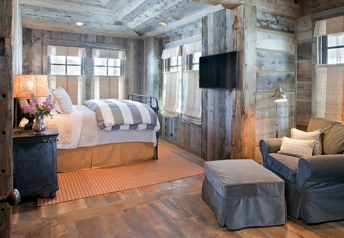 Reading-nook-in-ths-rustic-bedroom-is-fashioned-using-just-a-floor-lamp-comfy-chair-and-ottoman-96976