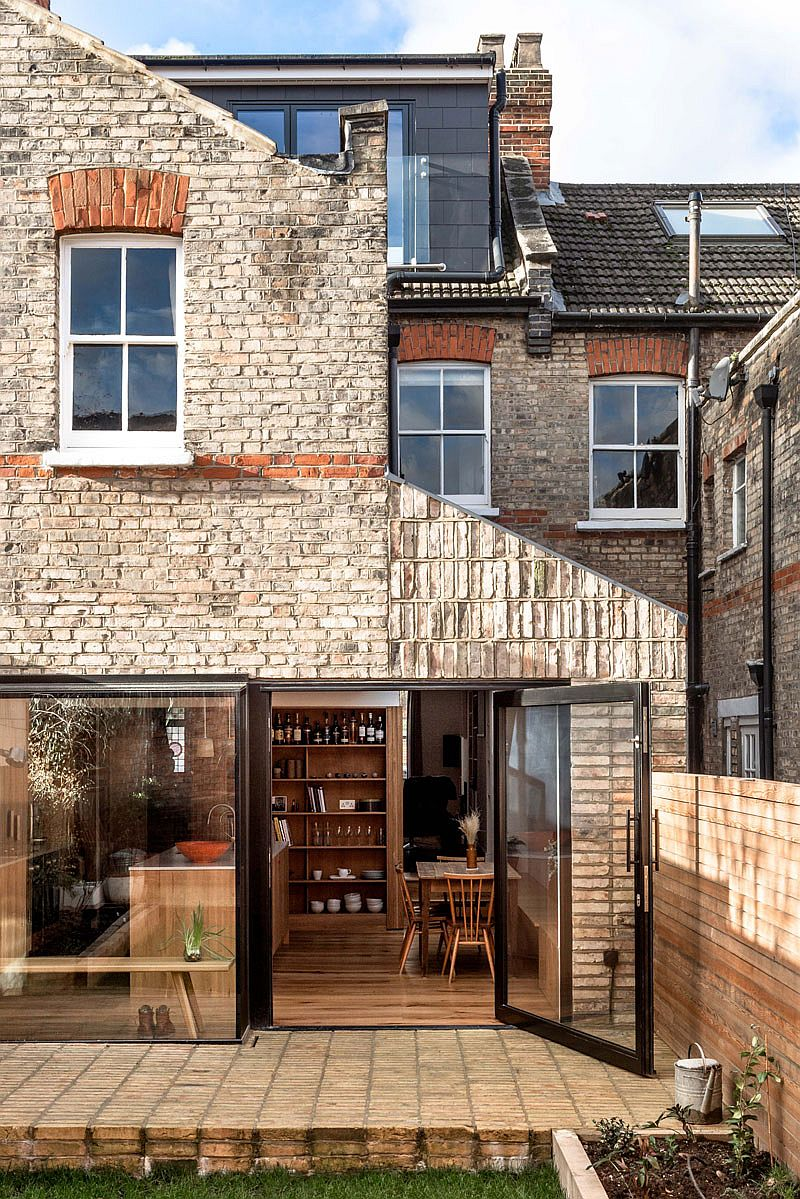 Recycled brick and oak extension of classic home in North London with a modern classic look