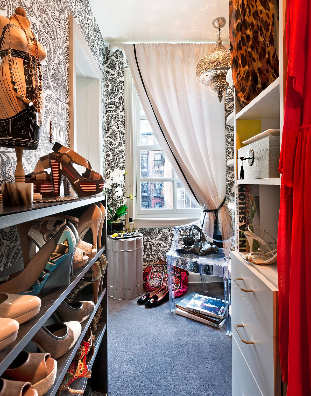 Repeating the drapery, wallpaper and other features used in the bedroom to create that perfect walk-in closet