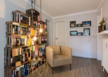 Repurposed-wooden-crates-have-been-used-to-create-a-custom-bookshelf-in-this-small-home-library-51313-217x155