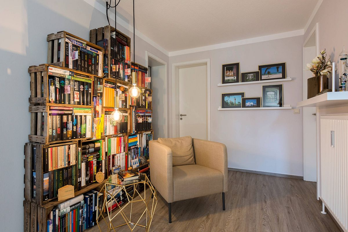 Repurposed-wooden-crates-have-been-used-to-create-a-custom-bookshelf-in-this-small-home-library-51313