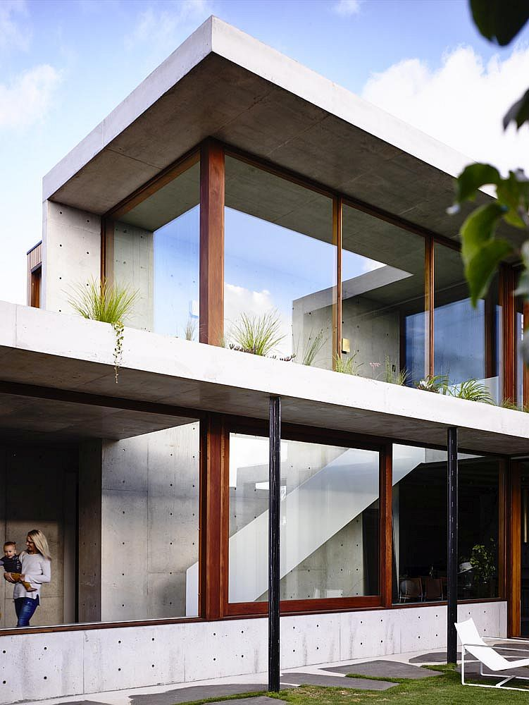 Sliding glass doors, concrete and greenery make the biggest impression inside this home