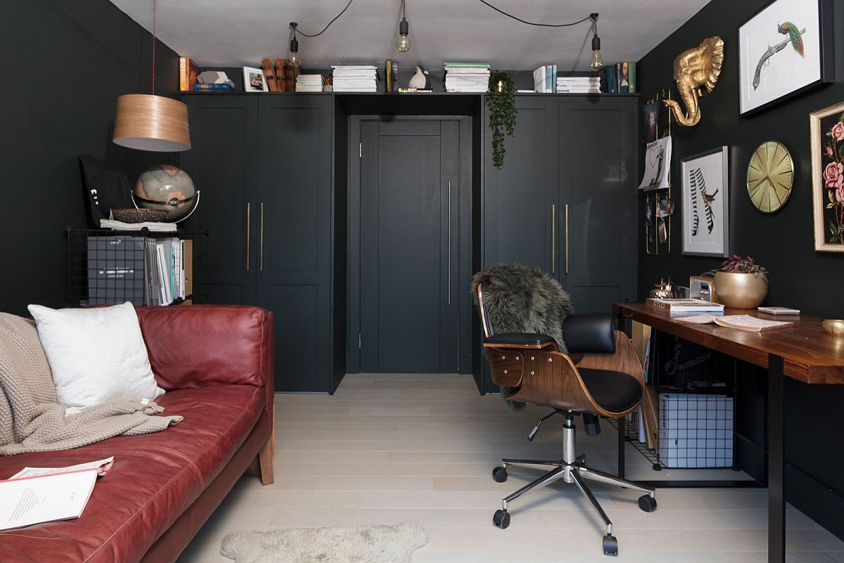 Small modern farmhouse home office with dark red sofa and space-savvy design