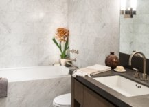 Small-rug-and-the-cusom-wooden-vanity-add-textural-contrast-to-the-modern-bathroom-in-white-97180-217x155