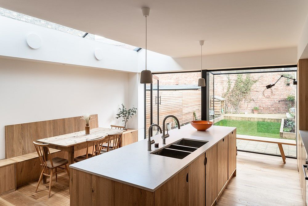 Smart white and wood modern kitchen of the Ogee House in North London