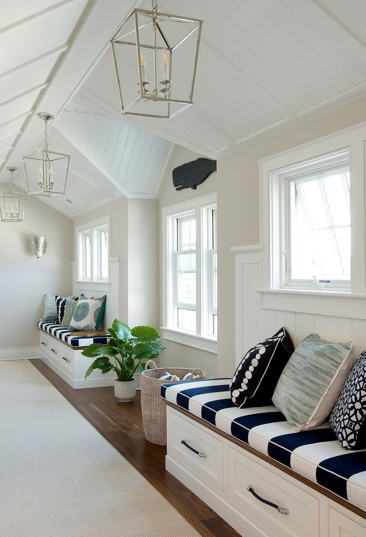 Spacious beach style hallway with custom built-in benches that offer plenty of storage space
