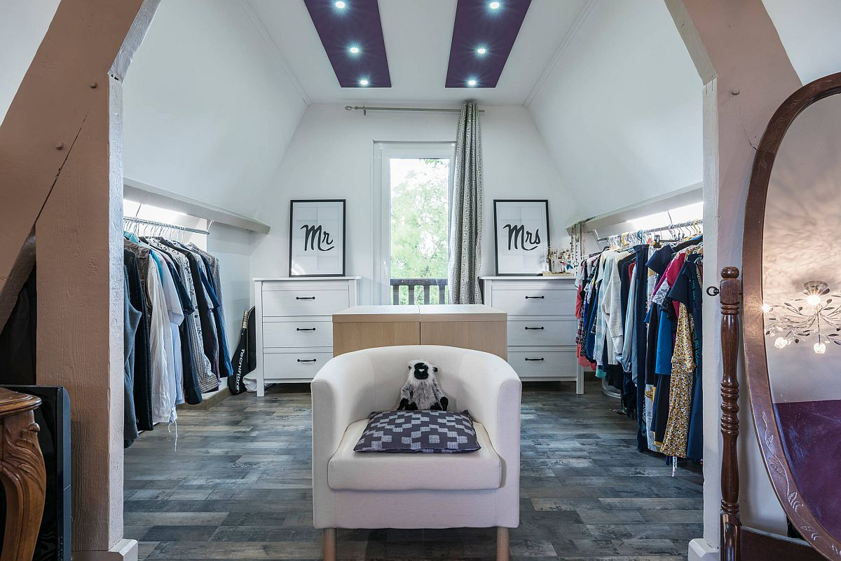 Spacious, gender-neutral eclectic walk-in closet on the attic levels with hangers and ample storage space