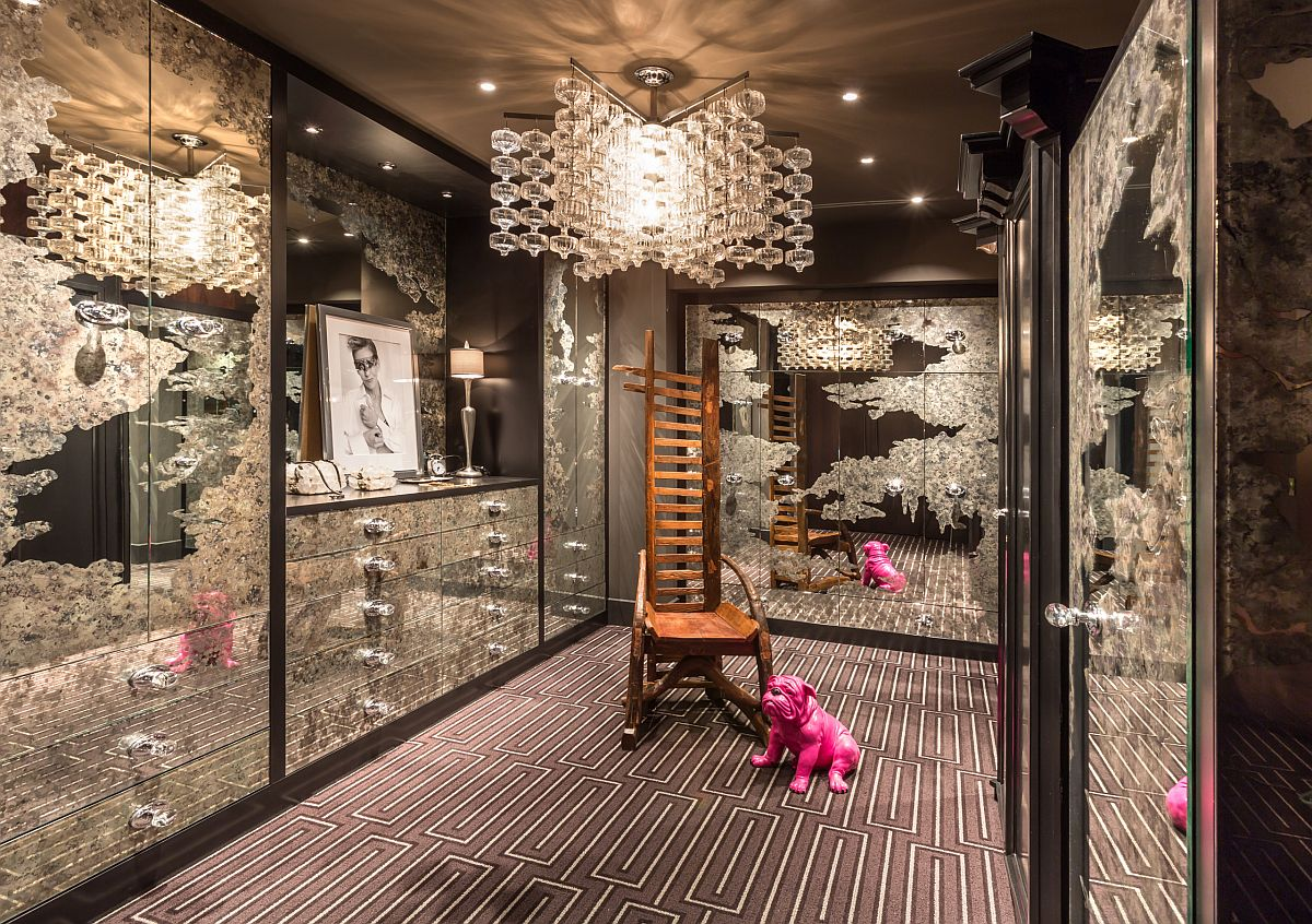 Stunningly beautiful eclectic walk-in closet with etched glass all around and a chandelier that steals the spotlight