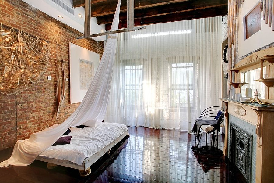 Textural contrast and roughness of the exposed brick wall coupled with softness of sheer curtains