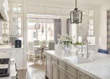 Traditional-kitchen-and-dining-are-aof-the-remodeled-home-in-white-with-gray-accents-and-drapes-41801-217x155