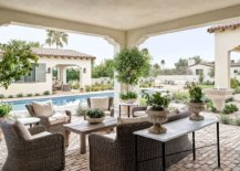 Traditional-outddor-sitting-space-and-poolside-deck-with-a-lovely-pool-house-next-to-it-87662-217x155