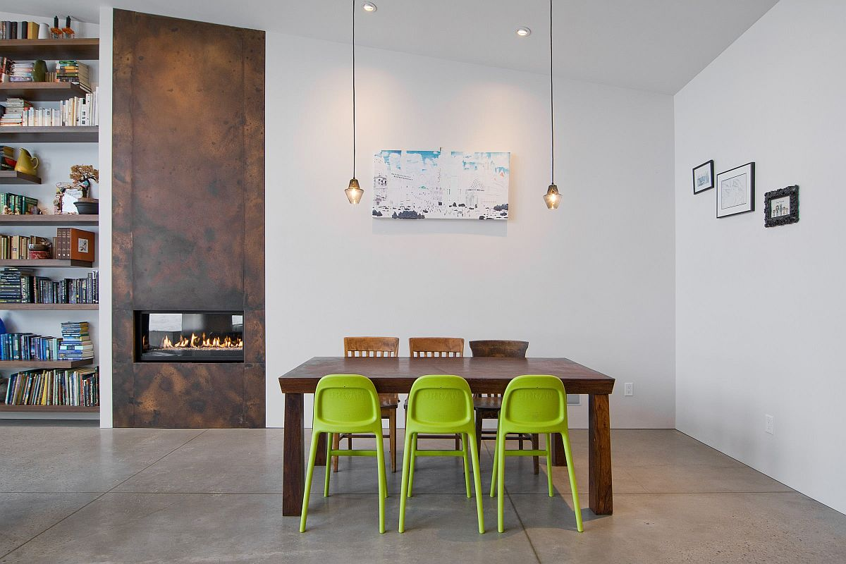Trio of green chairs bring color to this exquisite minimal dining room