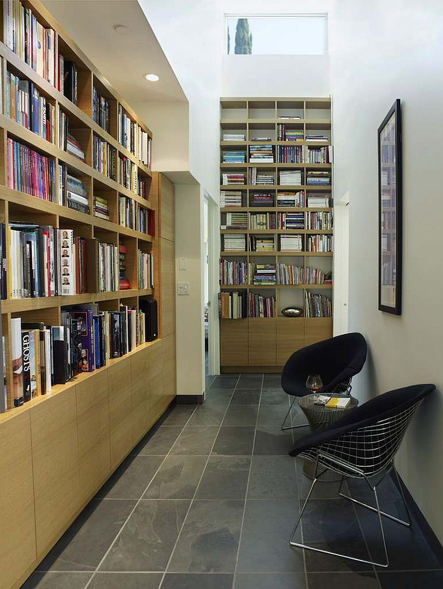 Turn the hallway into a home library and reading space with ample space for books and a couple of chairs