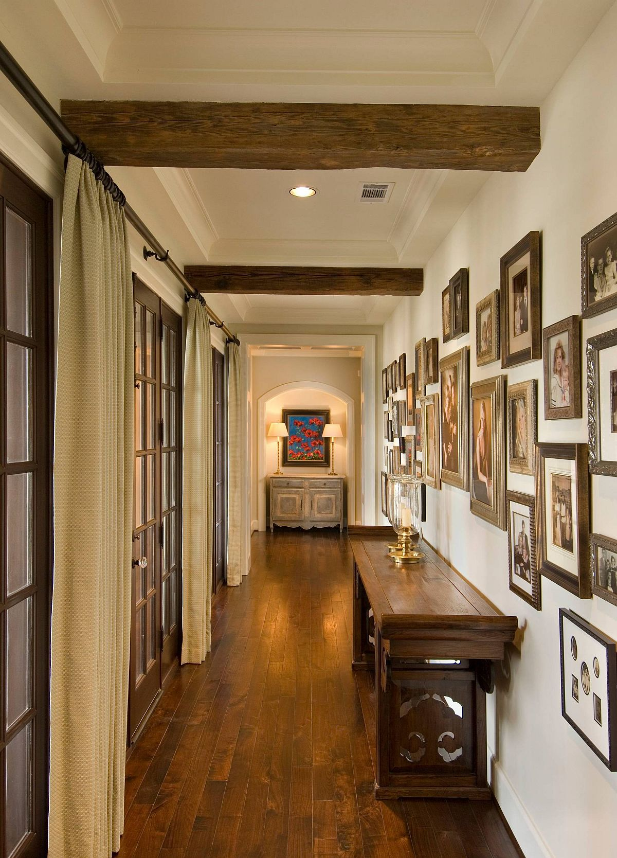 Using frames in similar finish gives this hallway a more beautiful visual appeal