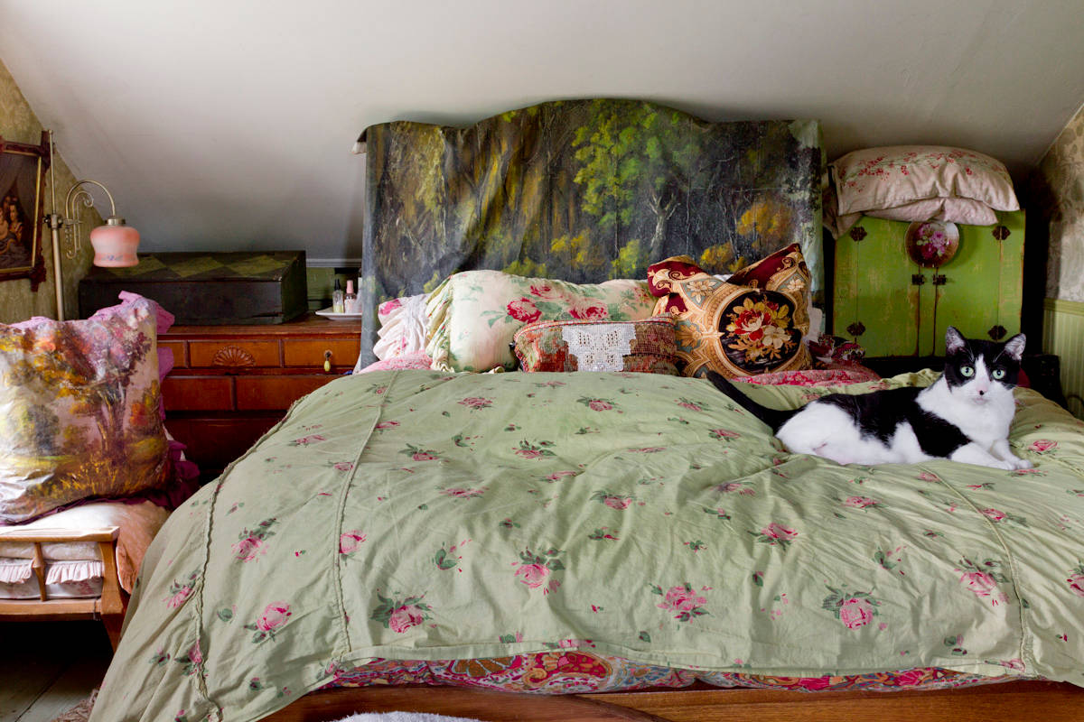 Ultra-small bohemian bedroom with colorful textiles and seamless bohemian charm