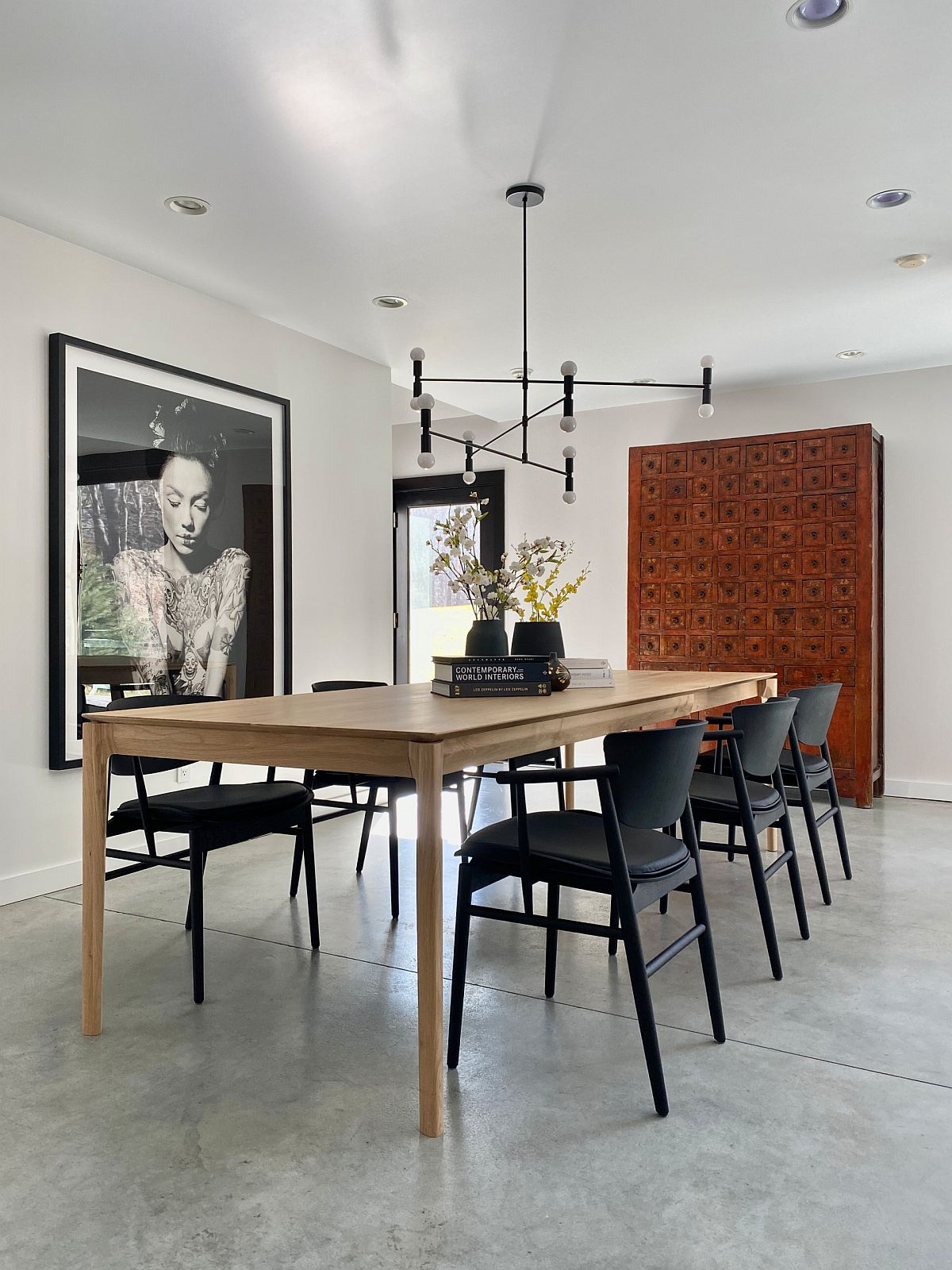 Use fabulous wall art pieces to give the minimal dining room a personality of its own