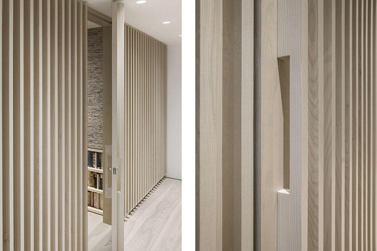Vertical battens shape the entry of the Manhattan loft
