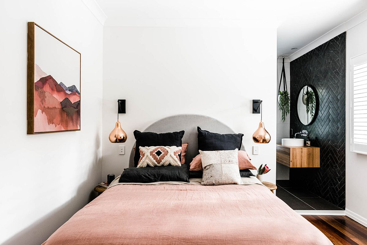 Wall art also adds color to the small Scandinavian style bedroom along with the bedsheets