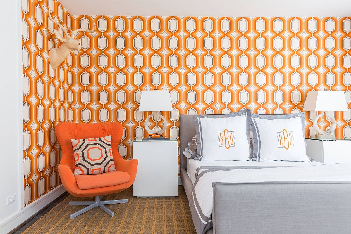 Wallpaper and chair bring in accent orange hue in here