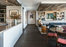 Wooden-ceiling-sections-delineate-the-kitchen-and-dining-area-from-the-living-room-18918-217x155