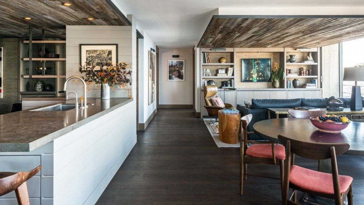 Wooden ceiling sections delineate the kitchen and dining area from the living room