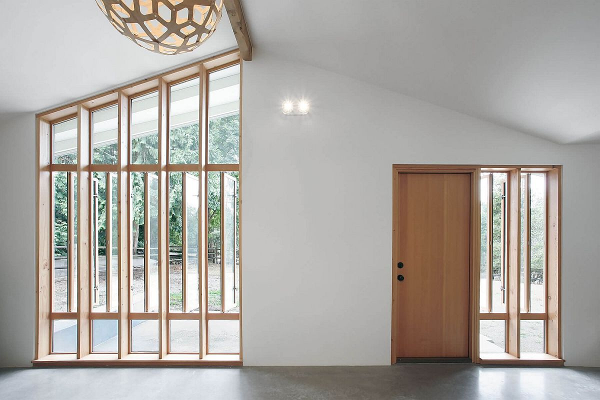 Wooden windows and doors swivel open to bring in more ventilation