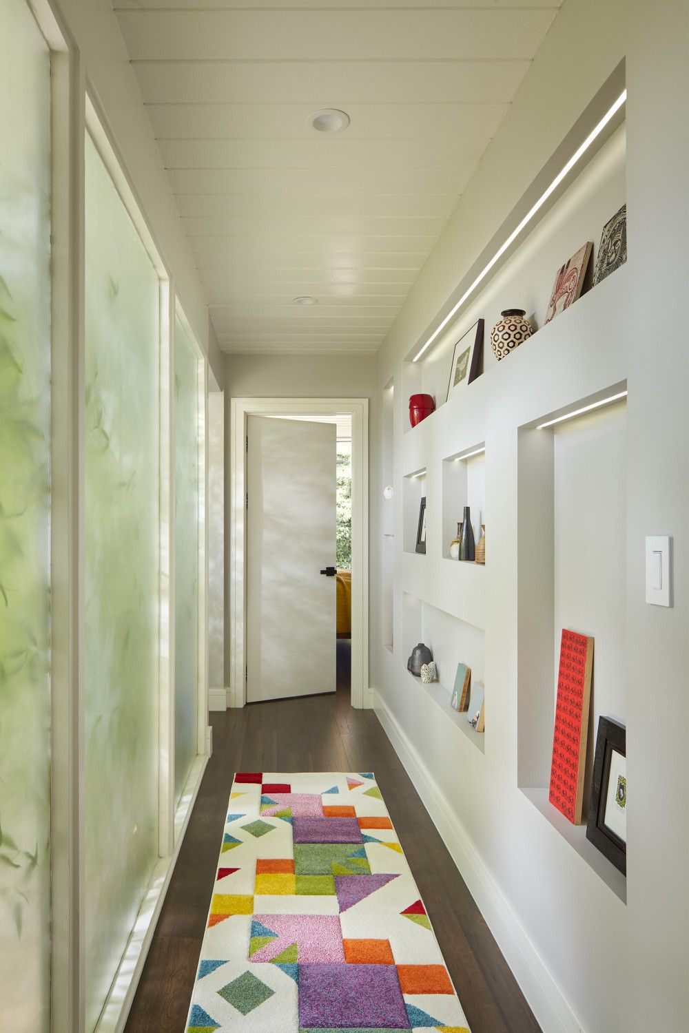 You do not need much shelf space to create a lovely display wall in the hallway