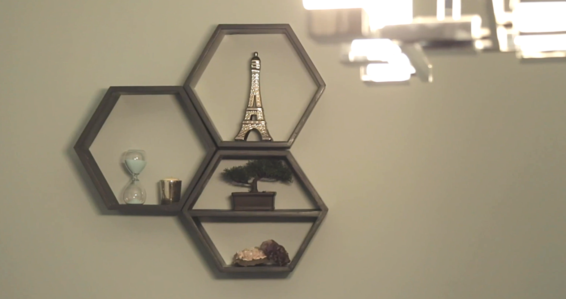three hexagon box shelves hanging on wall