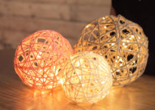 three different sized rope lanterns sitting on table