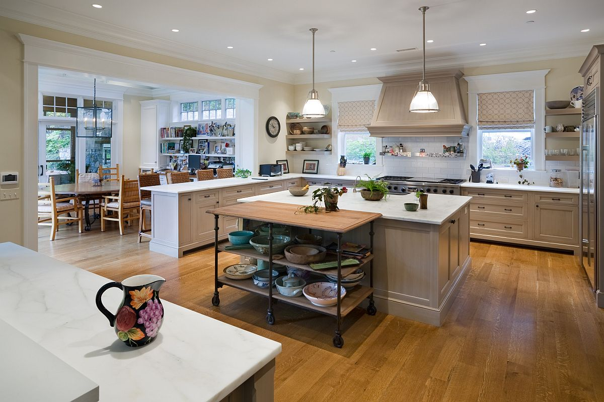 Add an open island on wheels in wood and metal to add prep and storage space to your existing kitchen island