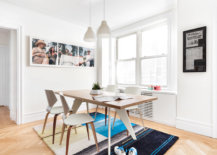 Add-color-to-the-small-dining-room-in-white-with-rug-and-wall-art-83537-217x155
