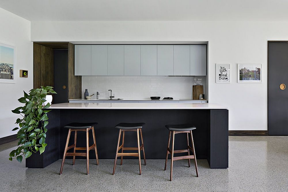 Balanced and modern kitchen design in neutral colors with smart cabinet design
