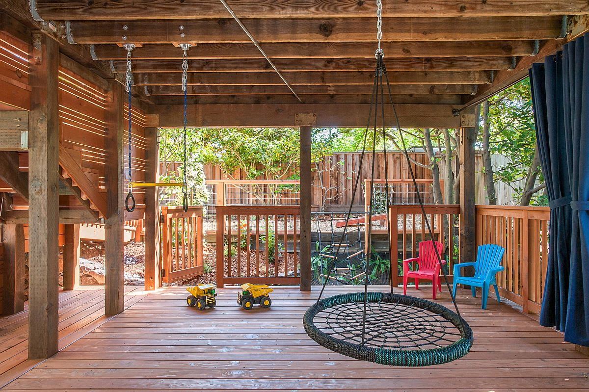 Beautiful wooden deck creates the perfect playarea for kids with shade, swings and ample space