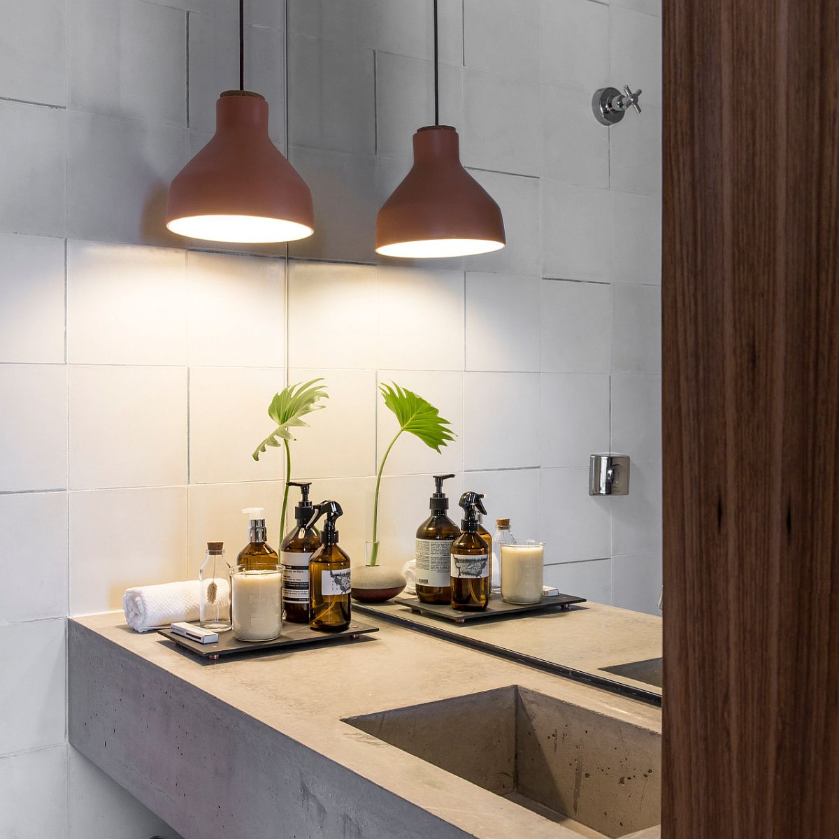 Bespoke concrete vanity and lovely pendant for the industrial-modern bathroom