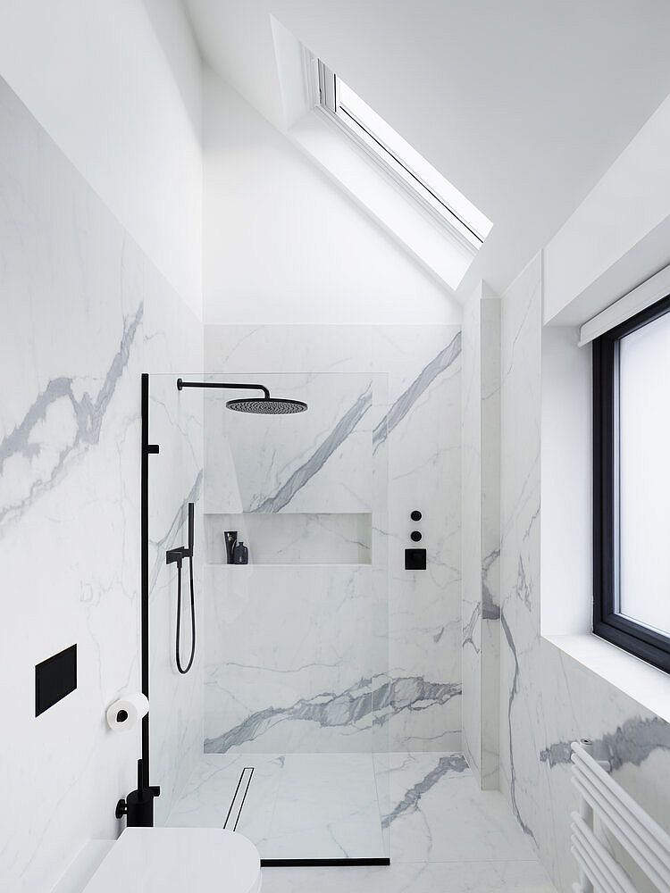 Bianco venato marble brings an air of luxury to the all-white bathroom