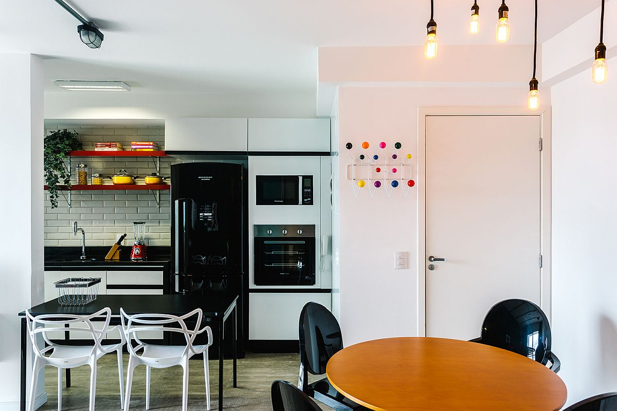 Black appliances coupled with black countertops in the kitchen add contrast to the interior