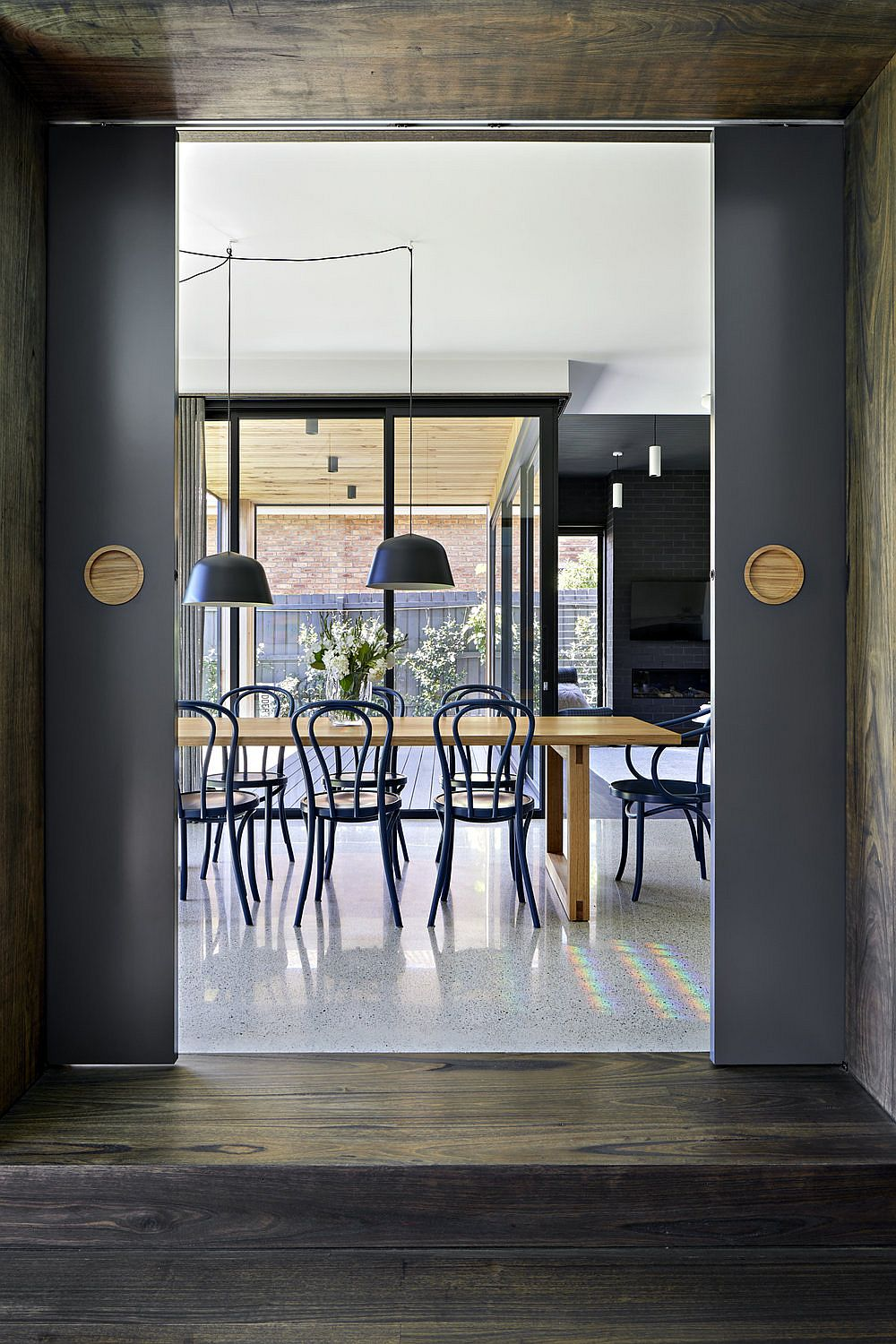 Bluish-gray shapes the dining area of the large family home with a renovated interior