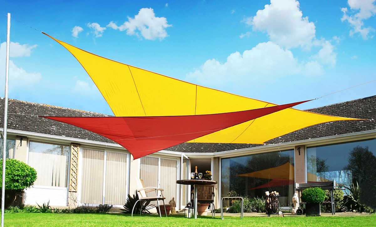 Brilliant and colorful use of sails to create shade for the backyard