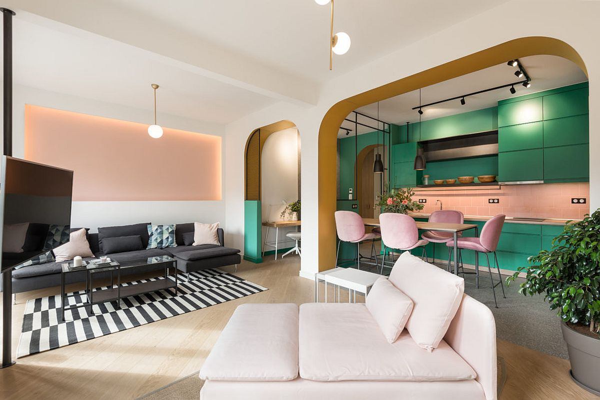 Brilliant pop of green, pink and golden yellow create a stunning and playful apartment interior