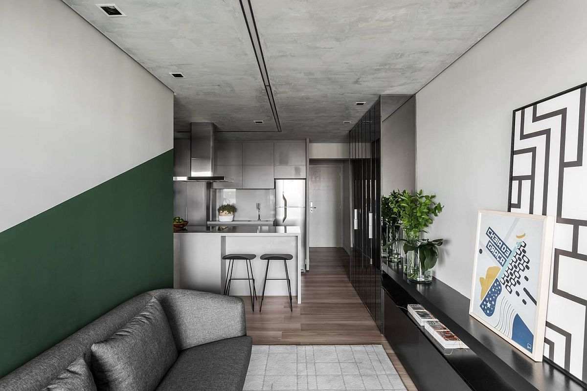 Burnt-cement-surfces-in-the-apartment-give-it-a-unique-appeal-while-green-brings-color-to-the-neutral-space-69055