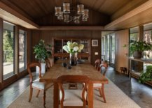 Cabin-style-dining-room-of-the-house-is-connected-with-the-outdoors-using-glass-walls-18585-217x155