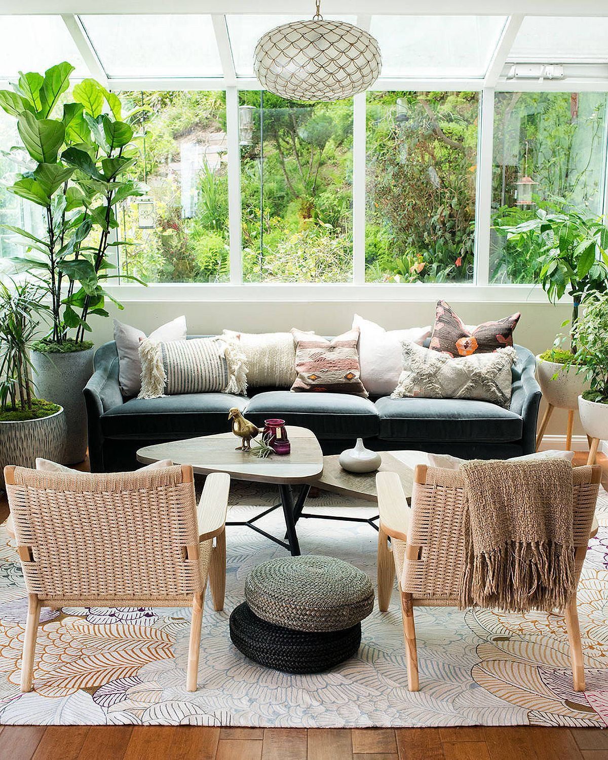 Comfortable modern decor can be combined with greenery to create the perfect small sunroom
