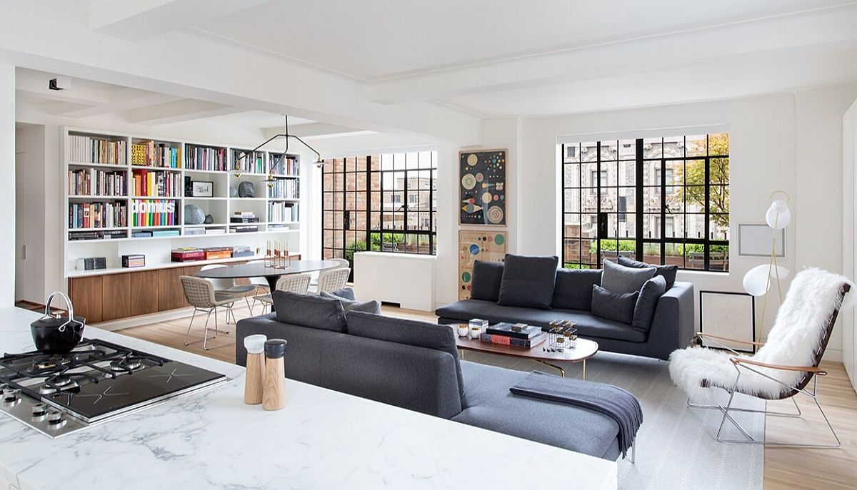 Contemporary decor, bespoke bookshelves and brilliant design transform this 1930's NYC apartment into a modern delight