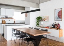 Contemporary-dining-table-and-chairs-in-wood-and-black-along-with-a-sleek-pendant-create-a-fab-dining-space-72908-217x155