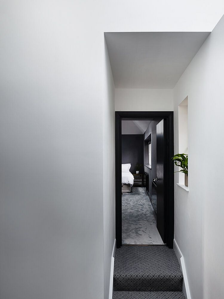 Corridor and staircase leading to the private upper level master suite of the revamped home in London