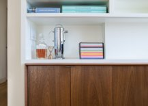 Creating-storage-space-inside-the-modern-apartment-with-lovely-wooden-cabinets-underneath-open-bookshelves-58364-217x155