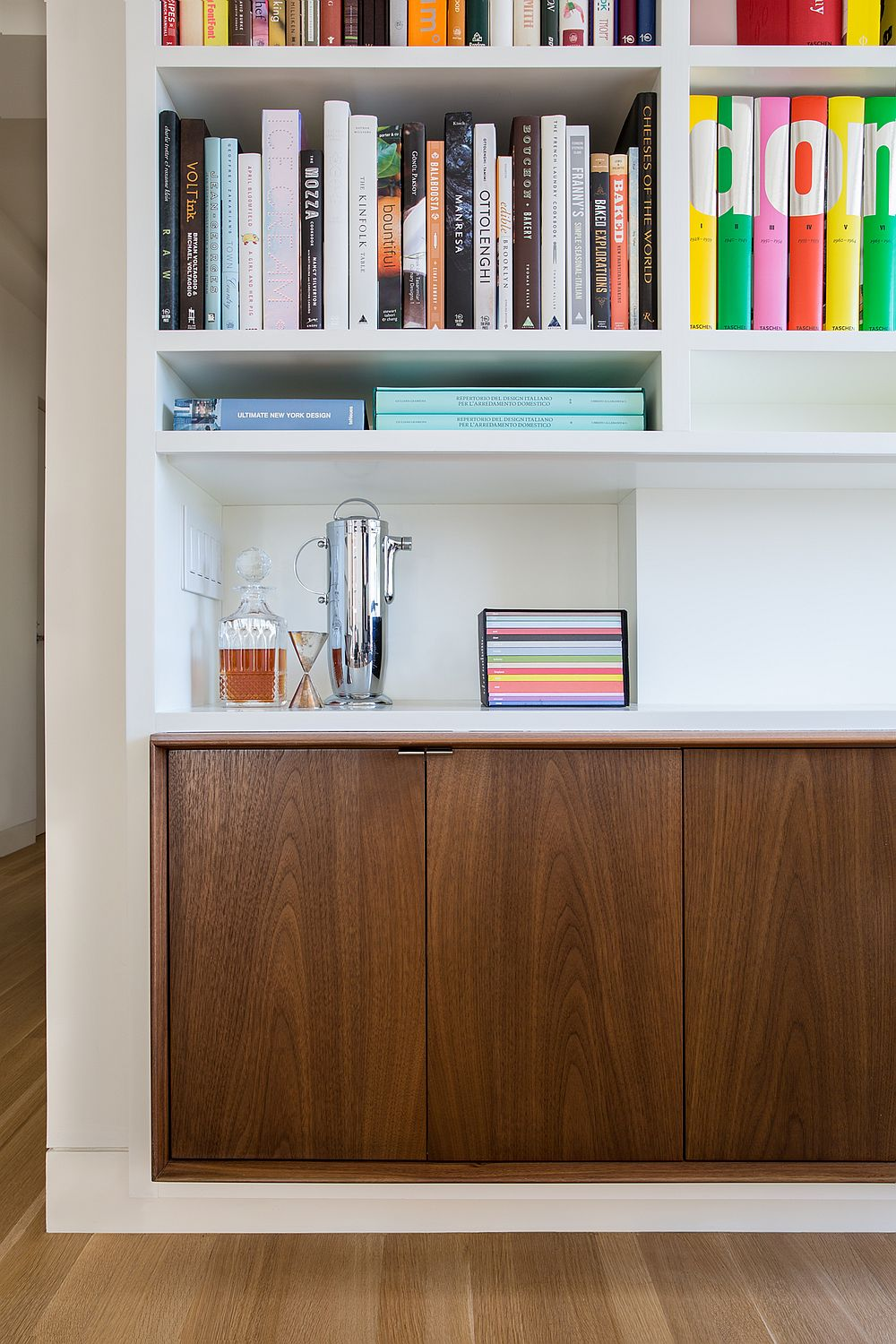 Creating-storage-space-inside-the-modern-apartment-with-lovely-wooden-cabinets-underneath-open-bookshelves-58364