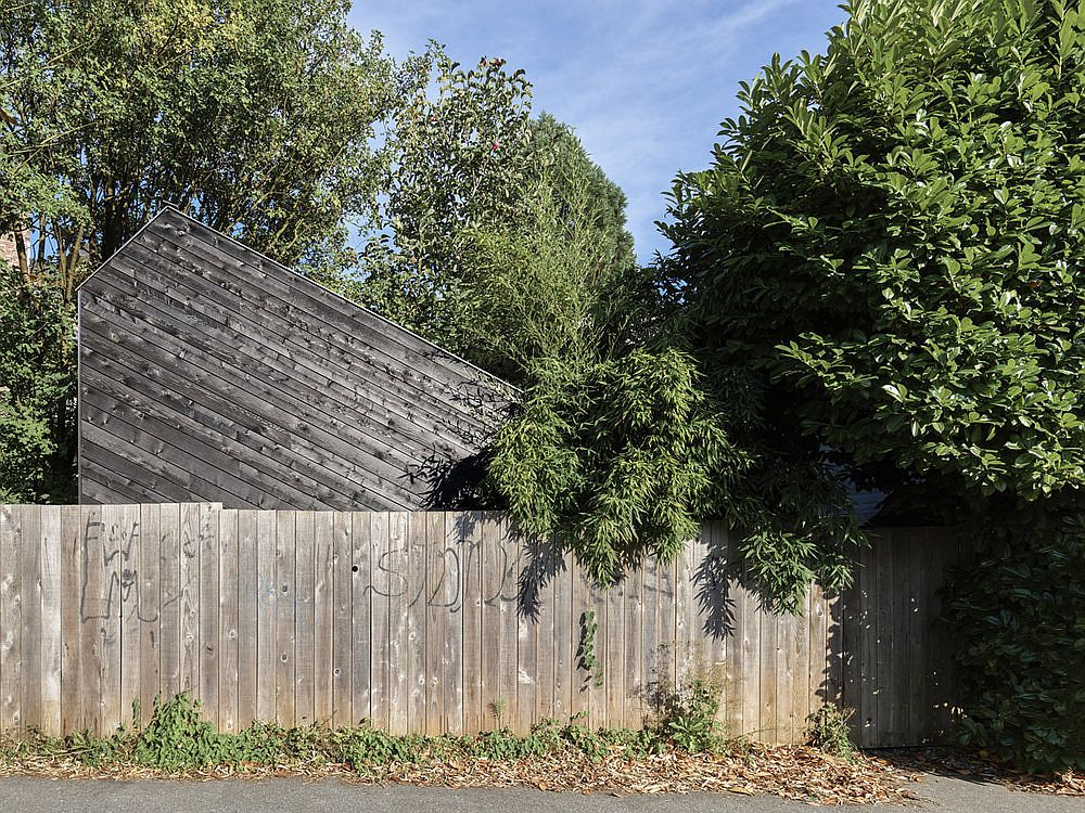Creative and space-savvy music shed with timber siding as viewed from the street